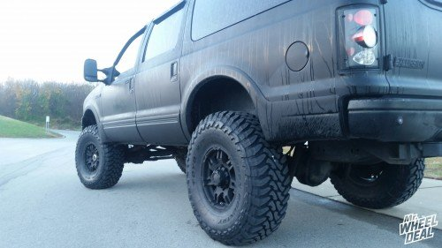 """17x9"""" Ultra Gauntlet Matte Black wheels with 40x13.50x17 Toyo Open Country MT tires on a 2000 Ford Exursion"""