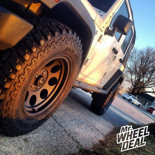 2012 Jeep Wrangler with 17x9 Pro Comp Alloy 7069 Flat Black wheels and LT285/70/17 Mickey Thompson Baja ATZP3 tires