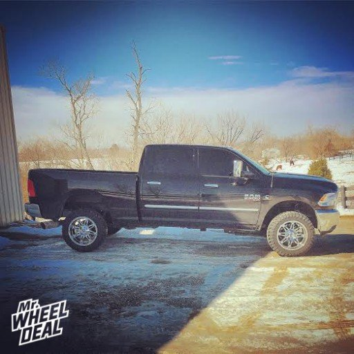 """20x10"""" PVD Chrome Fuel Hostage -24mm wheels with 33x12.50x20 Atturo Trail Blade MT tires on a 2014 Ram 2500"""