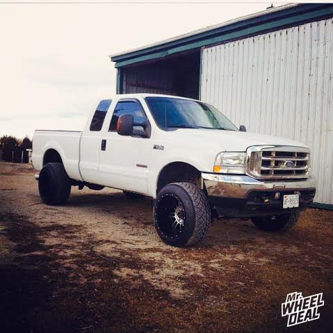 20x14 XD Series Riot 809 Black wheels with 305/50/20 Nitto Trail Grappler 420s tires on a 2004 Ford F250