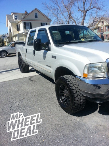 """18x9"""" XD Monster Black Wheels on a 2003 Ford F-250"""