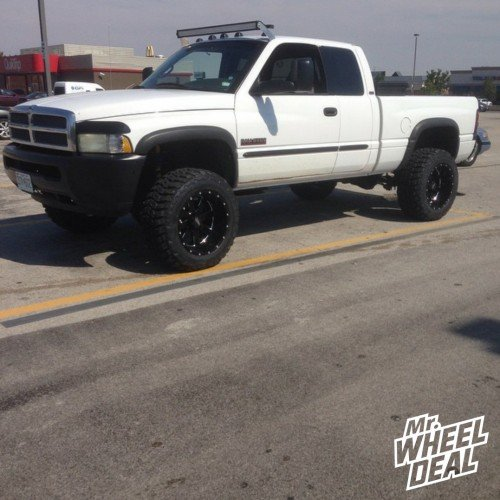 """20x12"""" Moto Metal 962 Black wheels with 35x12.50x20 Federal Couragia MT tires on a 2002 Ram 2500"""