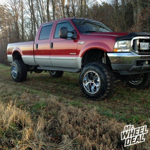 20x12 Fuel Off-Road Hostage Chrome wheels with 37X13.50R20 Nitto Mud Grappler tires on a 2003 Ford F-250