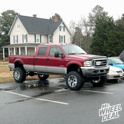 """20x12"""" Fuel Off-Road Hostage Chrome wheels with 37X13.50R20 Nitto Mud Grappler tires on a 2003 Ford F-250"""