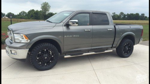 20x9 Black Fuel Off-Road Hostage wheels with 33x12.50x20 Toyo Open Country MT tires on a 2011 Ram 1500