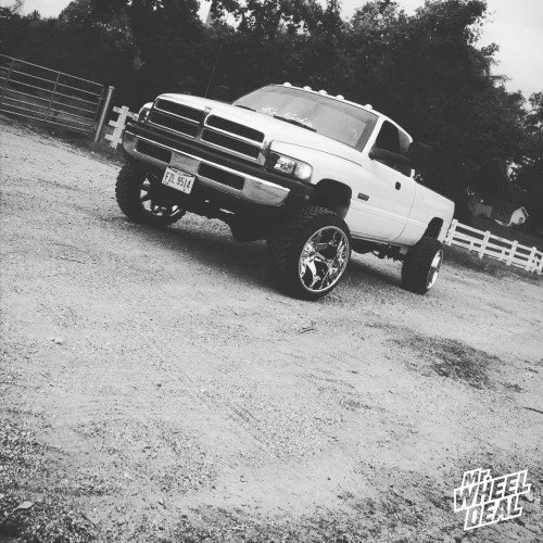 22x14 Fuel Offroad Octane wheels with 33x12.50x22 Atturo Trail Blade MT tires on a 2002 Ram 2500