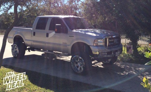 22x14 Armor Plate Chrome Hostile Havoc wheels with 33X12.50R22 Toyo Open Country MT tires on a 2007 Ford F-250