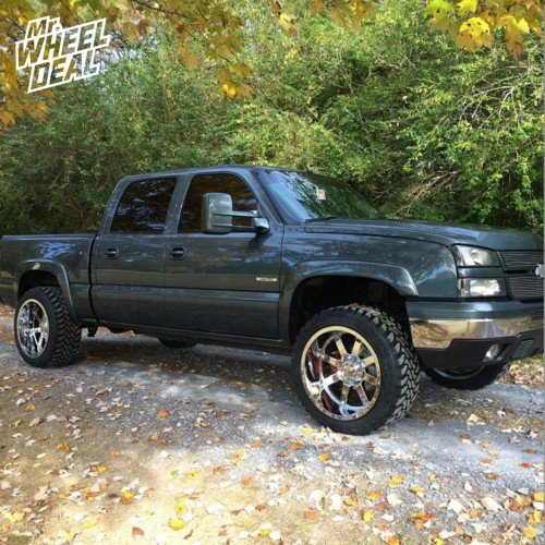 """22x12"""" Gear 726 Chrome wheels with 33x12.50r22 Toyo Open Country MT tires on a 2006 Chevy Silverado 1500"""