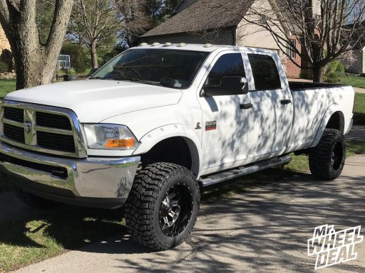 20x12 Fuel Offroad Crush Black wheels with 35X13.50R20LT Cooper Discoverer STT Pro tires on a 2011 Ram 2500