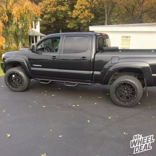 2008 Toyota Tacoma with 20x12 Black Vision Rocker -51mm wheels and 285/50 R20 Cooper Zeon LTZ tires