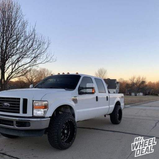 "22x12"" TIS 544BM Black Milled -44mm wheels with 35x12.50R22LT Road One Cavalry MT tires on a 2008 Ford F-250"