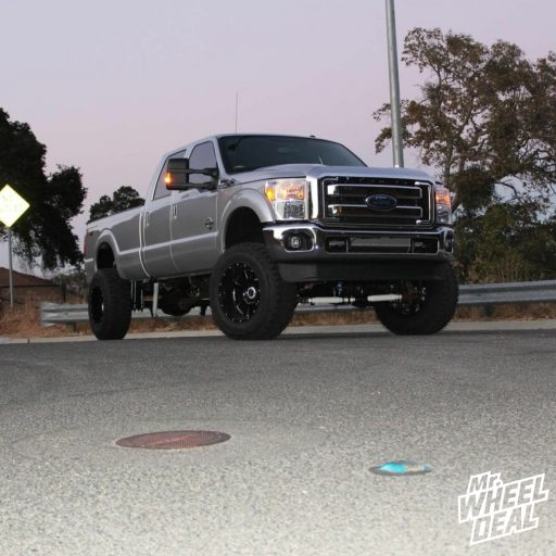 """2016 Ford F-250 with 20x12"""" Moto Metal MO962 Gloss Black Milled wheels and 37x12.50R20 Toyo Open Country RT tires"""
