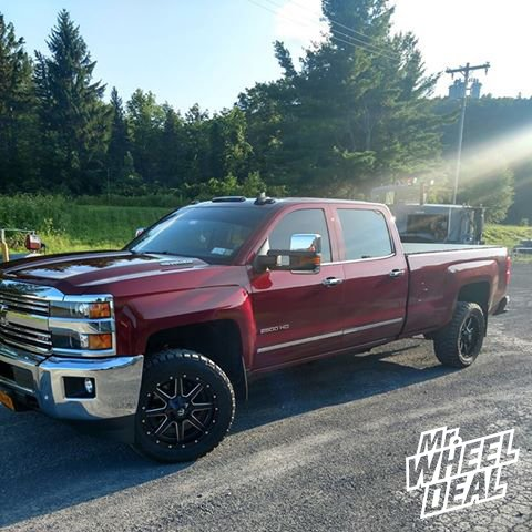 20x9 Black Milled Fuel Offroad Maverick wheels with LT285/55R20 Toyo Open Country RT tires on a 2015 Chevy Silverado 2500HD