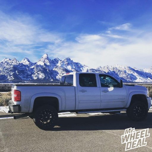 """20x10"""" Fuel Offroad Krank Black wheels with LT305/55R20 Toyo Open Country ATII tires on a 2013 Chevy Silverado 3500HD"""