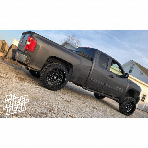 2011 Chevy Silverado 1500 with 22x12 Black Milled Hostile Sprocket -44mm wheels and 33x12.50R22LT Atturo Trail Blade MT tires