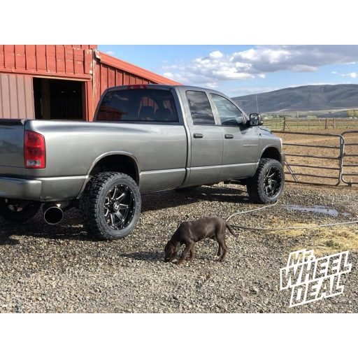 2006 Ram 3500 with 20x10 Black Milled Hostile Alpha wheels with LT295/55R20 Toyo Open Country RT tires