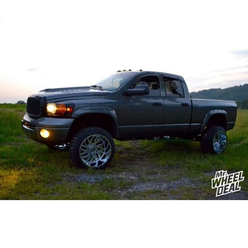 2007 Ram 2500 with 22x14 TIS 544V PVD Chrome wheels and 33x12.50R22LT Road One Cavalry M/T tires