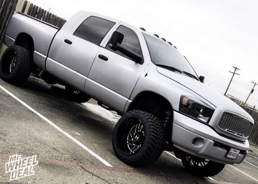 2007 Dodge Ram 2500 with 22x14 -76mm Black Milled Hostile Jigsaw wheels and LT355/40R22 Nitto Trail Grappler tires