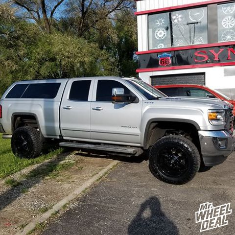 2017 GMC Sierra 2500 with 20x10 Fuel Coupler Gloss Black wheels with LT295/60R20 Nitto Ridge Grappler tires