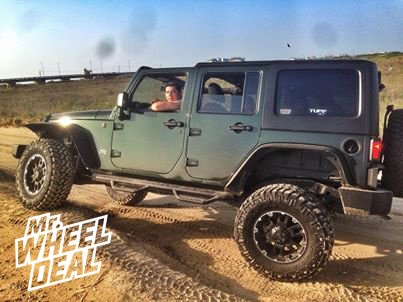 "17x8"" Tuff T-04 Black Wheels with 35x12.50x17 Nitto Trail Grappler Tires on a 2011 Jeep Wrangler"