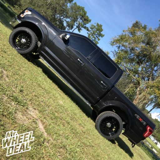 "2015 Ford F-150 with 22x12"" American Force Trax SS Gloss Black Solid wheels with 33x12.5R22LT Nitto Ridge Grappler tires"