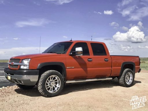 2004 Chevy Silverado 2500 with 20x10 Hostile Demon -19mm Chrome wheels and LT33X12.50R20 Fuel Mud Gripper tires