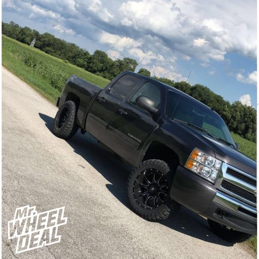 "2011 Chevy Silverado 1500 with 20x10"" Black Fuel Vandal -18mm wheels and 33x12.50R20LT Fury Offroad Country Hunter MT tires"