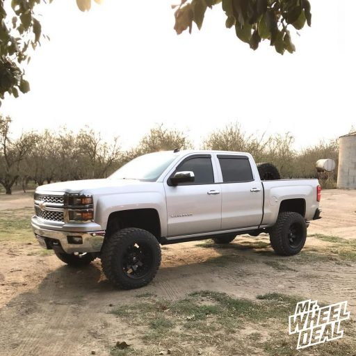2014 Chevy Silverado 1500 with 20x12 Black Fuel Octane wheels and 35X12.5R20LT Atturo Trail Blade MT tires