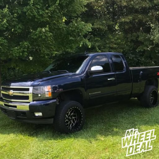 20x12 Black Moto Metal 985 wheels with 305/50R20 Toyo Proxes S/T tires on a 2011 Chevy Silverado 1500
