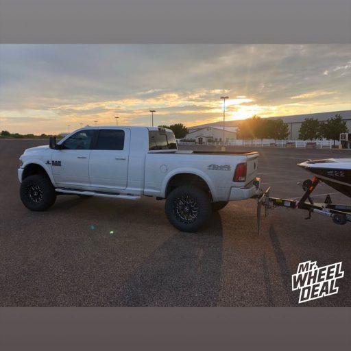 "20x10"" Black Milled Hostile Sprocket -19mm wheels with 37x13.50R20LT Nitto Ridge Grappler tires on a 2018 Ram 2500"