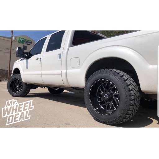 """2014 Ford F-250 with 20x12"""" TIS 544BM -44mm Black Milled wheels and 35X12.50R20LT Cooper Discoverer S/T Maxx tires"""