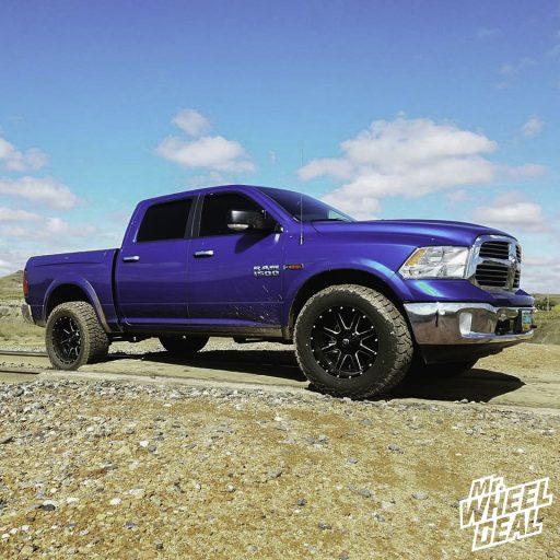 2015 Ram 1500 with 20x10 -24mm Black Milled Fuel Maverick wheels and 35x12.50R20LT Falken WildPeak AT3W tires