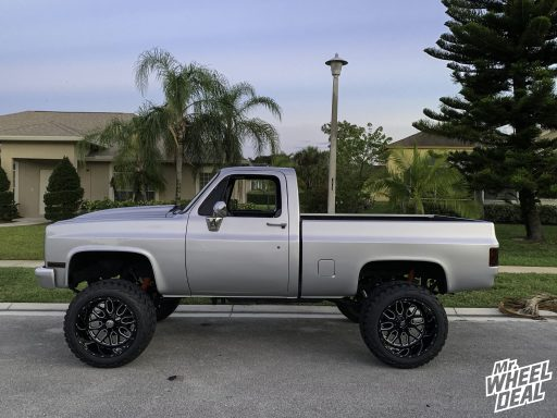 1985 Chevy with 22x14 -75mm Black Fuel Titan wheels and LT325/50R22 AMP Mud Terrain Attack MT A tires