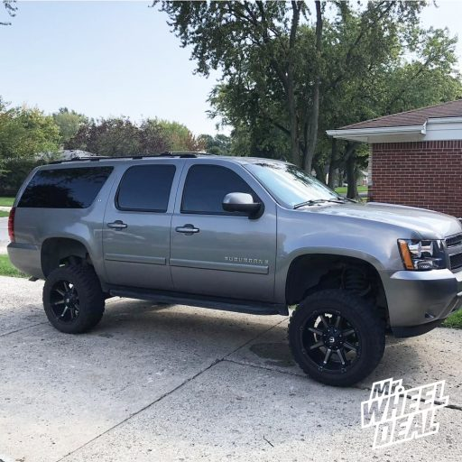 """20x10"""" Black Fuel Off-Road Coupler -24mm wheels with 33x12.50R20LT Free Passer X-Cross M/T tires on a 2007 Chevy Suburban 1500"""