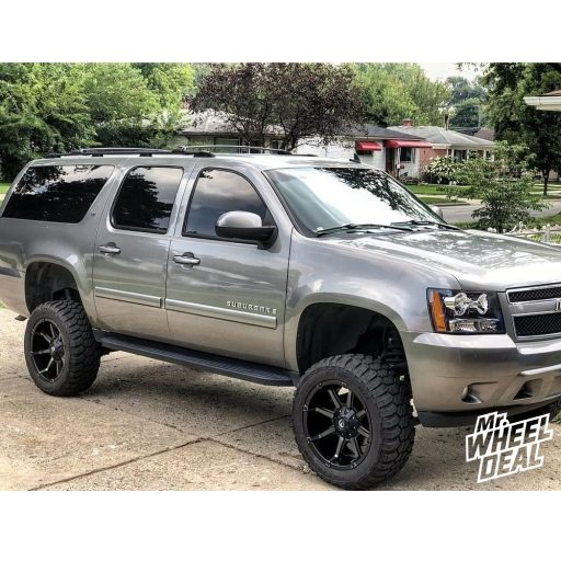 2007 Chevy Suburban 1500 with 20x10 Fuel Off-Road Coupler -24mm Black wheels with 33x12.50R20LT Free Passer X-Cross MT tires