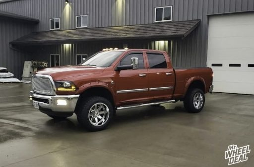 2010 Dodge Ram 3500 with 20x12 -44mm Chrome Hostile Alpha wheels and 33x12.50R20LT Toyo Open Country A/T II tires