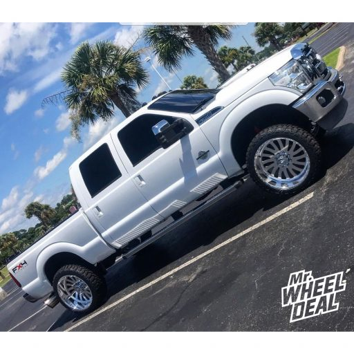 2011 Ford F-350 with 24x12 Polished American Force Octane SS wheels and 35x12.50R24 Haida Mud Champ tires