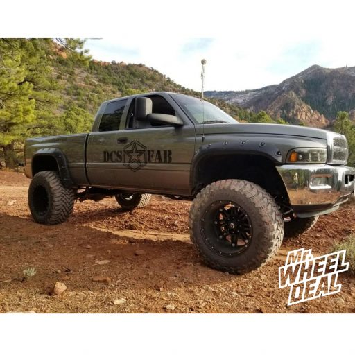 "20x14"" Black Fuel Off-Road Hostage -76mm wheels with 38x15.50R20LT Toyo Open Country MT tires on a 2000 Dodge Ram 2500"