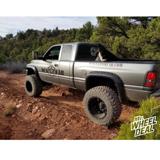 2000 Dodge Ram 2500 with 20x14 Fuel Hostage -76mm Black wheels and 38x15.50R20LT Toyo Open Country MT tires