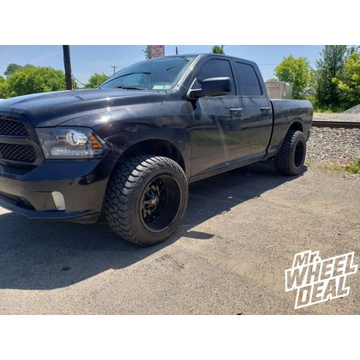 2014 Ram 1500 with 20x12 DWG Offroad DW13 -44mm Gloss Black wheels and LT305/55R20 AMP Terrain Gripper AT G tires