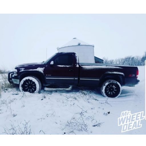 1999 Chevy Silverado 1500 with 20x10 Fuel Hardline -18mm Black wheels and LT305/55R20 AMP Terrain Gripper AT G tires