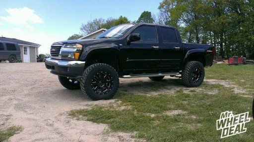 2009 GMC Canyon with 18x9 Moto Metal 962 Black Wheels with LT285/65/18 Nitto Trail Grappler Tires