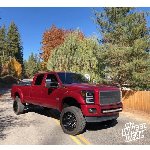 2015 Ford F350 with 22x12 Black Milled Fuel Stroke -44mm wheels and 35x12.50R22LT Nitto Terra Grappler G2 tires