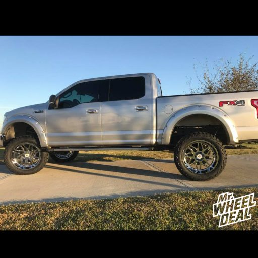 "22x12"" Chrome Hostile Sprocket -44mm wheels with LT325/50R22 AMP Mud Terrain Attack MT A tires on a 2017 Ford F-150"