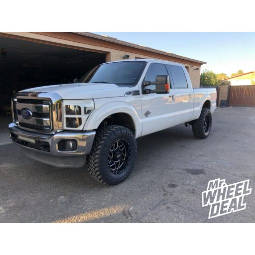 2013 Ford F250 with 20x9 XD836 Fury Black Milled wheels and 37X12.50R20LT Toyo Open Country MT tires