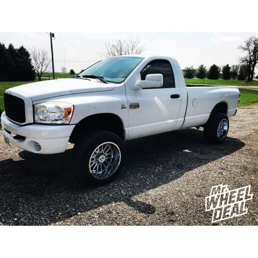 2007 Ram 2500 with 20x12 Chrome Hostile Predator wheels and 305/50R20 Nitto NT420S tires