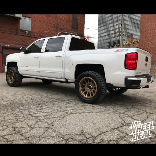 20x10 Bronze Method NV -24mm wheels with 33X12.50R20LT Toyo Open Country RT tires on a 2017 Chevy Silverado 1500
