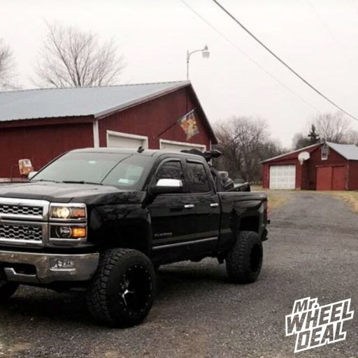 """2014 Chevy Silverado 1500 with 20x14"""" Hostile Switch Blade wheels and 35X13.50R20LT Toyo Open Country RT tires"""