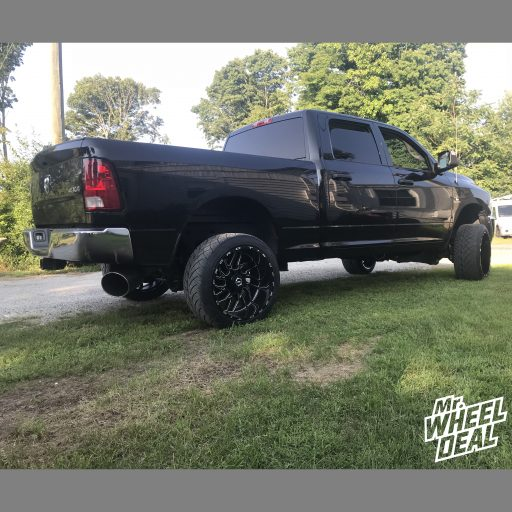22x12 Black Milled TIS 544BM wheels with 305/40R22 Nitto NT420S tires on a 2016 Ram 2500
