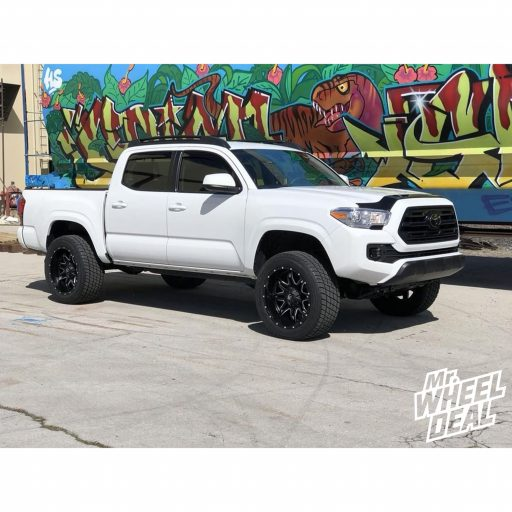 2018 Toyota Tacoma 4WD with 20x10 Fuel Off-Road Lethal Black wheels and 285/50 R20 Cooper Discoverer HT Plus tires